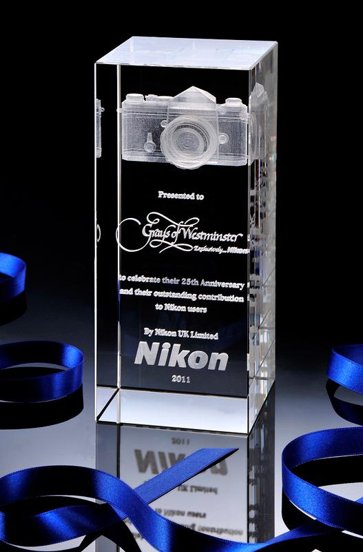 Nikon Awards Crystal Trophy to Grays of Westminster for 25 Years