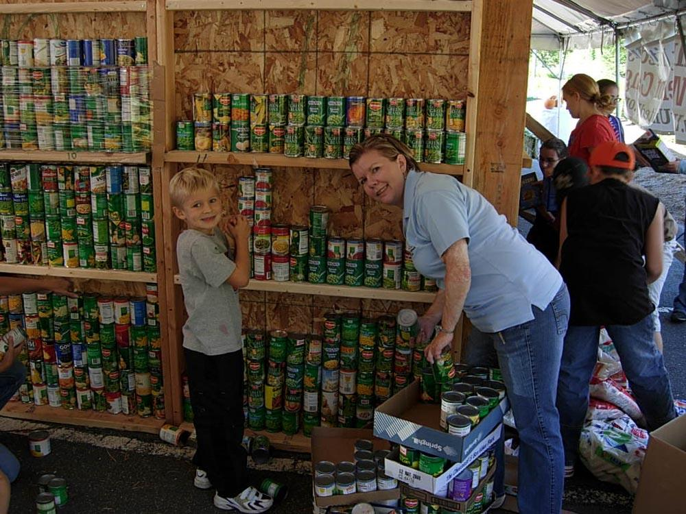 Julie Morelli and Sam Bemer helping on site with the Harvest House.