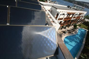 TiSUN modul collectors on the roof of the main building of Hotel Olira catch the sun's rays for hot domestic demand and swimming pools and cover 99% of the hot water demand