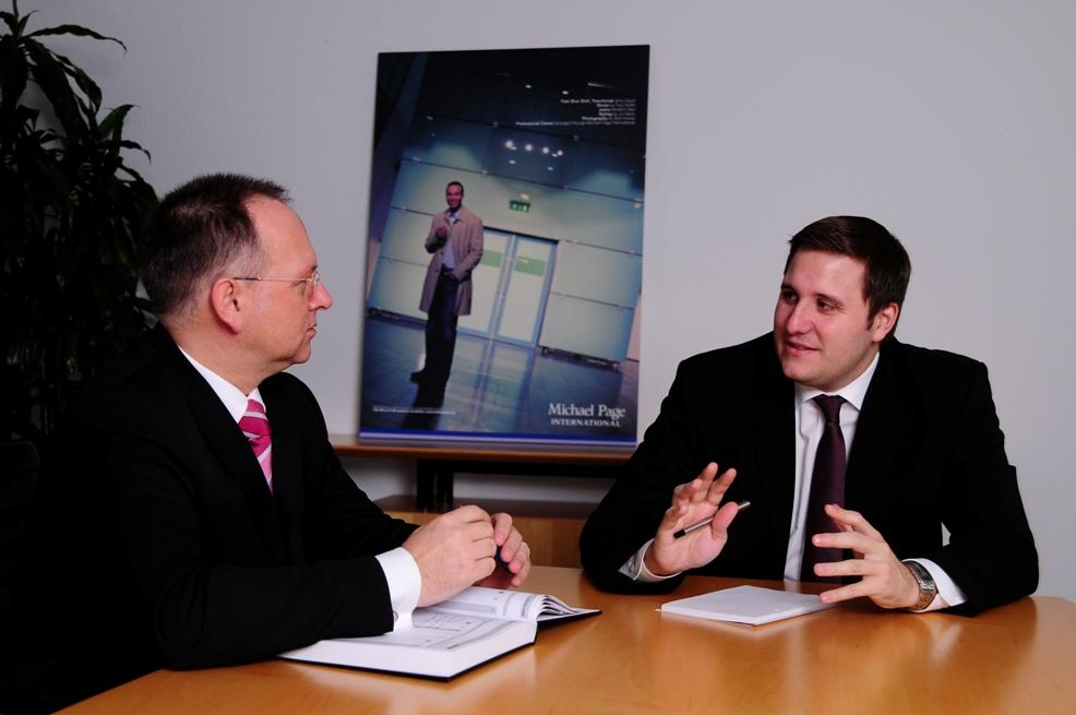 Wilfried Roettgers (mitcaps GmbH) and Christian Trein (Michael Page)