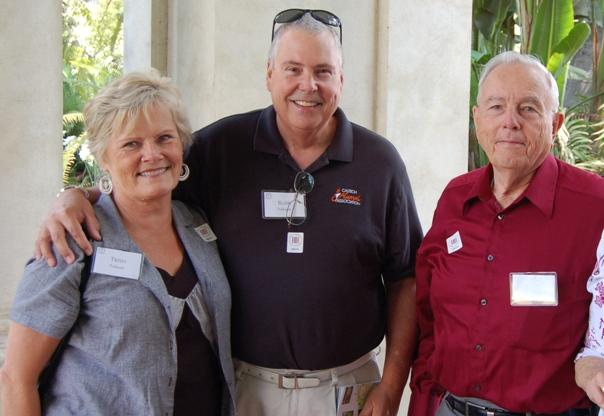 Associates Trish and Blair Folsom stand with Associate Richard Nesbit in front of the newly renovated Huntington Art Gallery