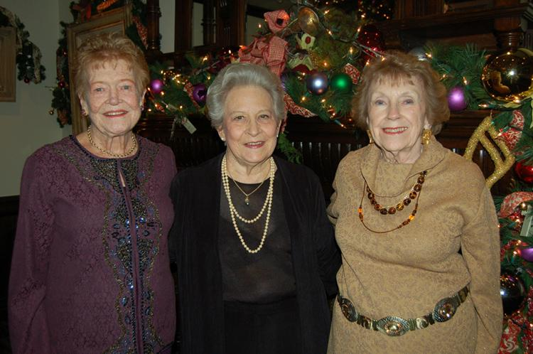 From L to R: Holiday Chairs Beth Yale, Aline Kuhnle, and Barbara Robison take some well-deserved time out for a photo keepsake of their hard work in planning Hillsides Guild's Holiday Celebration at the Parkway Grill. Photo by: Marisol Barrios/Hillsides