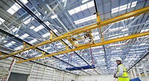 Hinged, multi-span cranes are unusual but essential in aircraft production where wide bays are common.