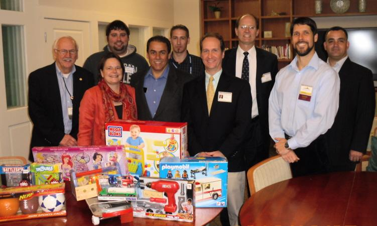 Rainmakers BNI members contribute to Toys for Tots.