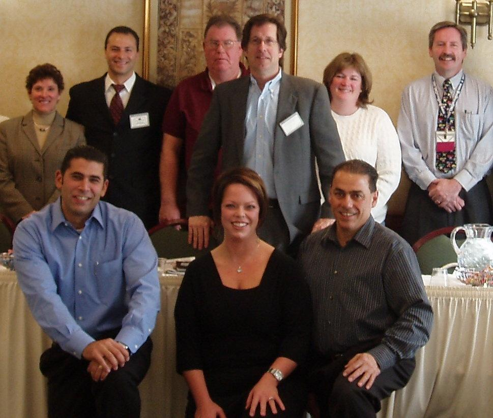 BNI  Chapter President Michael Terry Inducts three new members (front L?R)  Ramzi Nuwayhid- Financial Planner, Kat Gomez- Therapeutic Massage & Bodywork, Donald Schiarizzi- Realtor