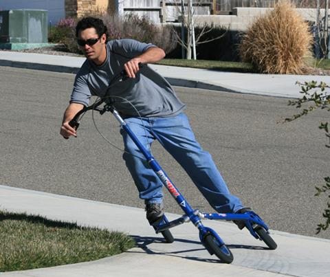 A commuter glides to work on the Trikke CV, the fuel-free, human-powered carving vehicle.