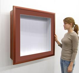 SwingFrame Shadowbox Display Case with wood frame, white interior and 12 inch depth