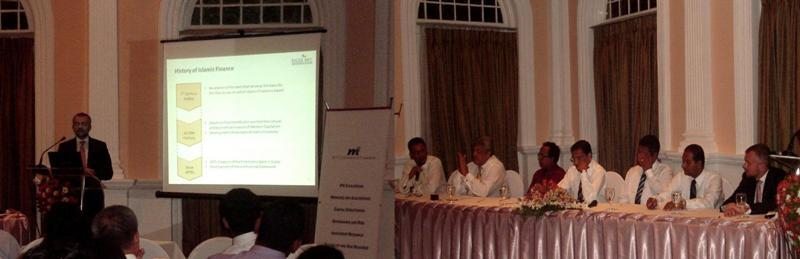 Photo Caption (L-R): MTI's Speaker Xavier Jopart presenting to the audience and the MTI?s Corporate Finance Team seated