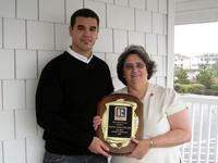 Michael Harrington, Resort Realtys Corporate General Manager with Mercedes Tabano, REALTOR of the Year Recipient