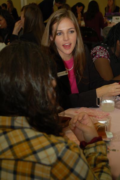 Rose Queen Evanne Elizabeth Friedmann, from La Canada High School having tea with the girls from Hillsides