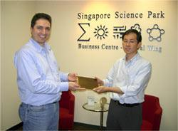 TPG Managing Director Stavros Georgantzis hands over the TPG Authorized Partner Plate to Nah Wee Yang, CEO of Systemethod.