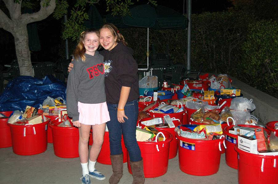 NCL Pasadena members, Claire Sigler, from Sacred Heart and Gaby Ciulla from Holy Family Drop Thanksgiving Baskets to Hillsides