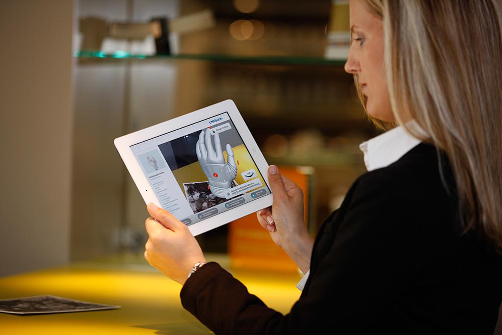 Woman with iPad and augmented reality presentation by Ottobock.