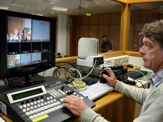 Rudi Luik in one of the control rooms for the transmission of lectures and presentations.