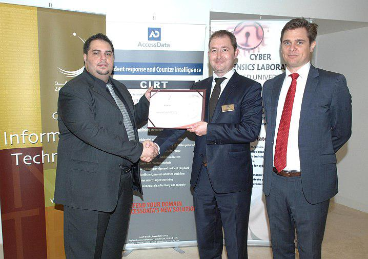 Dr. Ibrahim Baggili from Zayed University (L) presenting the 'Friend of Zayed University' certificate to AccessData executives