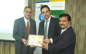 Mohammad Mobasseri, Senior Vice President, Comguard presenting award to partners