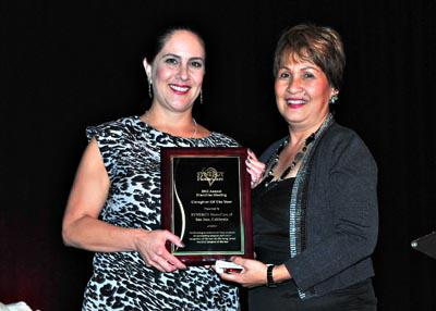 Carrie Casillas presents Caregiver of the Year award to Marleen Murillo