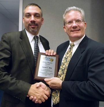 Aaron Bills (right) accepts ISSA award from Stephen Battista, SVP of ISSA's Northern Virginia chapter.