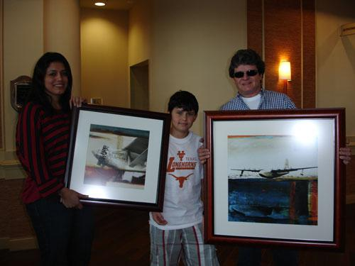 """The Biesuz family (Val, Pedro and Eloy) show off their new artwork, """"Spirit of St. Louis"""" and """"Spruce Goose"""" from the Martin-Young"""