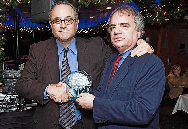 Attorney Jeffery M. Leving with Art Kallow as he accepts an award.