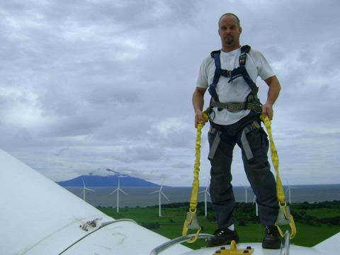 Up in the Air: High in the air: Carsten Brønd on top of a wind turbine