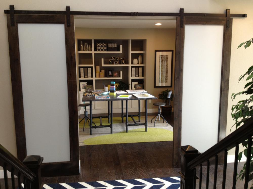 Goldberg Brothers barn door track hardware helps homeowners make more efficient use of living space.