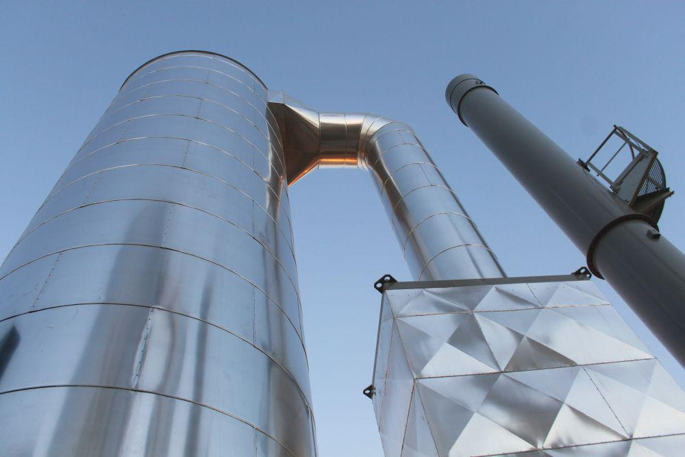 The photo shows one of the three boilers in vertical design.