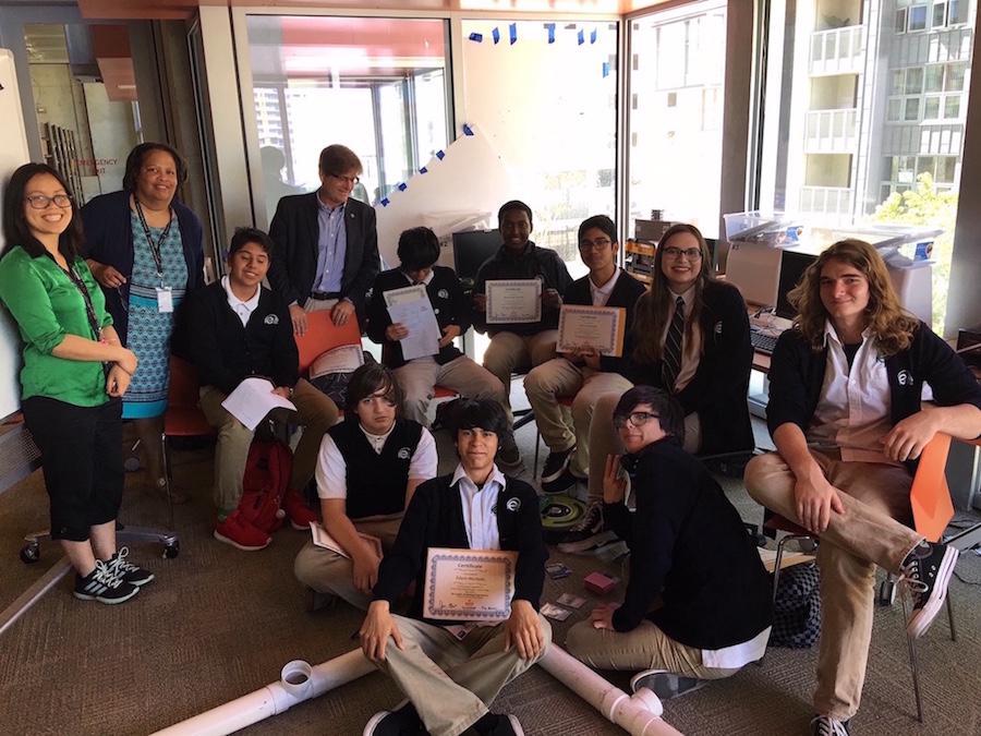 E3 graduating class displaying their level 0 graduation certificates.