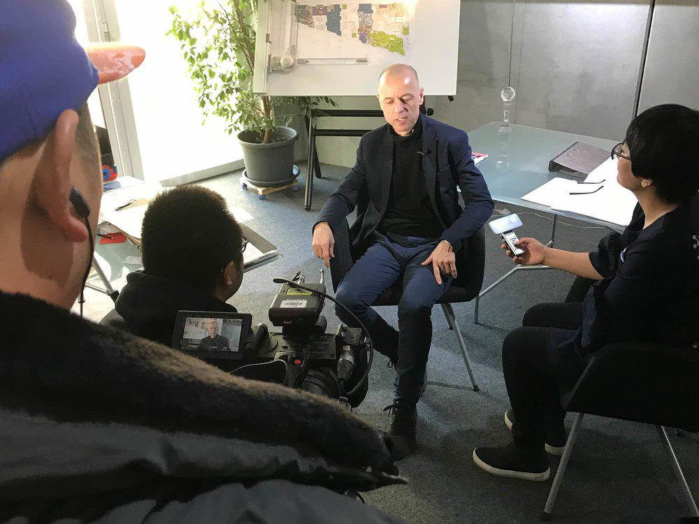 A Chinese camera team interviews architect Wolfgang Frey
