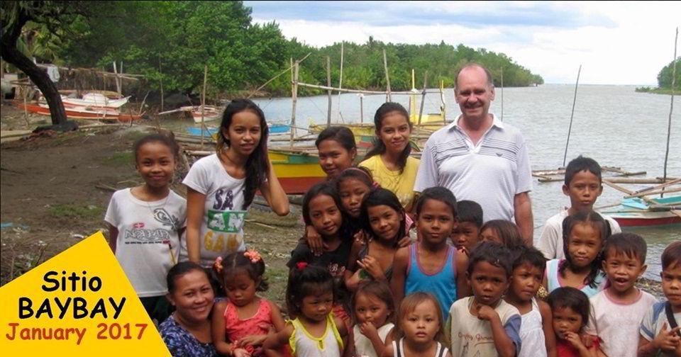 Ron Brown, Managing Director of Casa Esperanza of Angels Foundation with some of the children of Sitio Baybay.