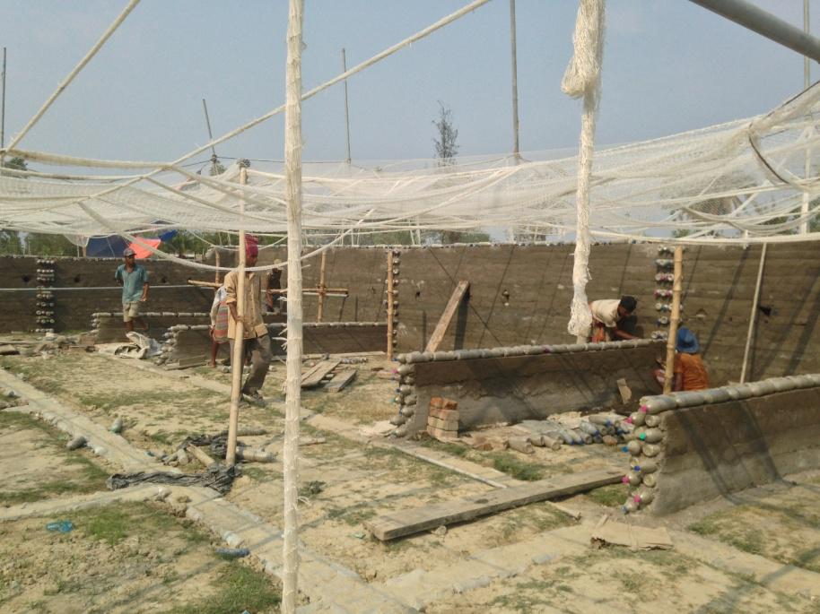 Bottle House Construction with Eco-construction technology with waste plastic bottles and fish net
