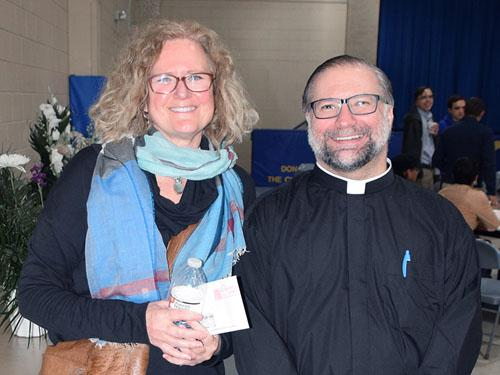 NorthPointe's CEO, Dina Donohue-Chase, (left) with Father Paul Stemn at the Knight of Columbus' check presentation.