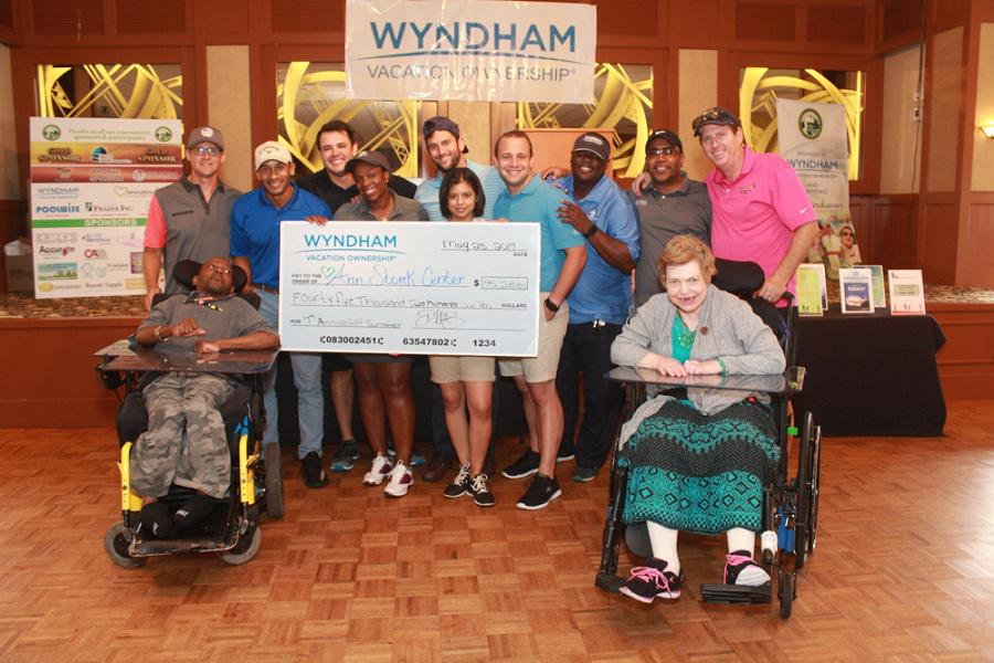 Wyndham Vacation Ownership and Ann Storck Center (ASC) employees with two ASC individuals.