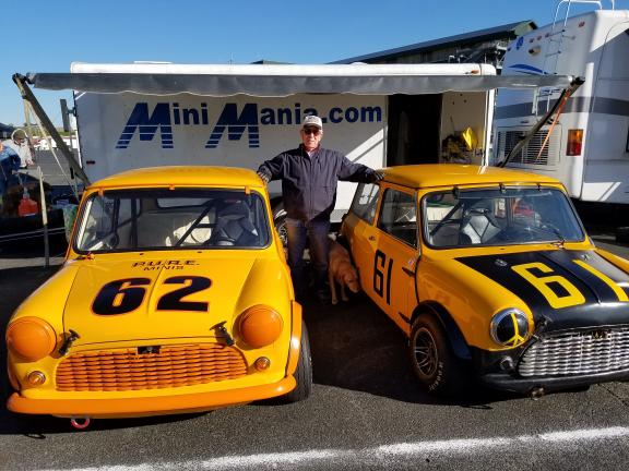 Don Racine and two of his classic fleet of championship-winning Mini Coopers