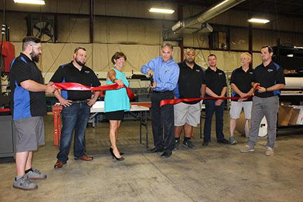 David Puleo cuts the ceremonial ribbon for RAPID Turbo Cell.