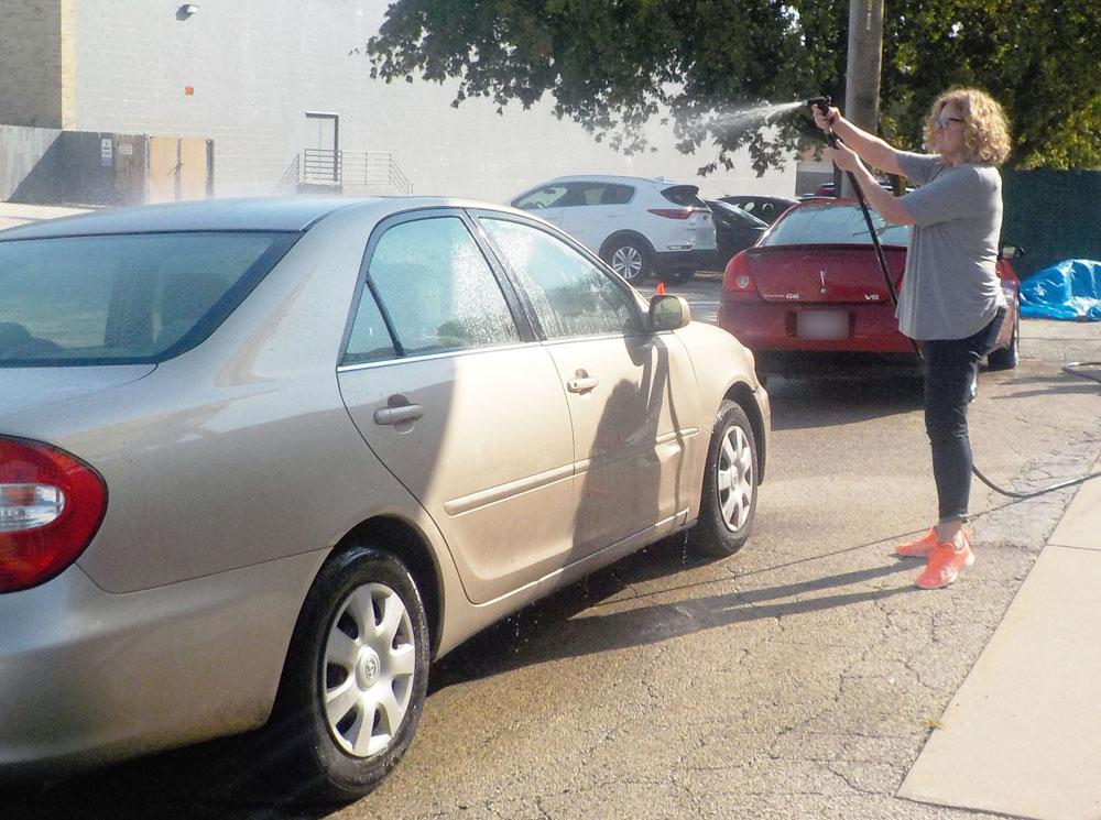 Dina Donohue-Chase, CEO, NorthPointe Resources, participates in the employee appreciation car wash.
