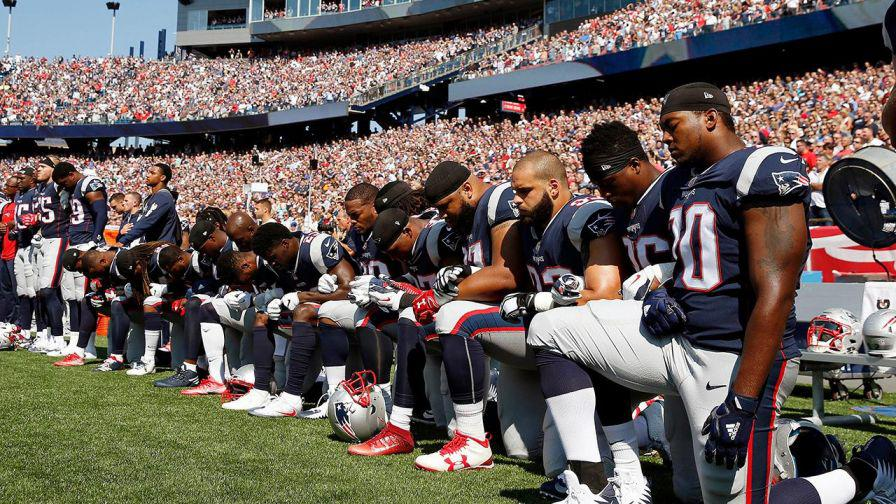 Football Players Kneel in Protest