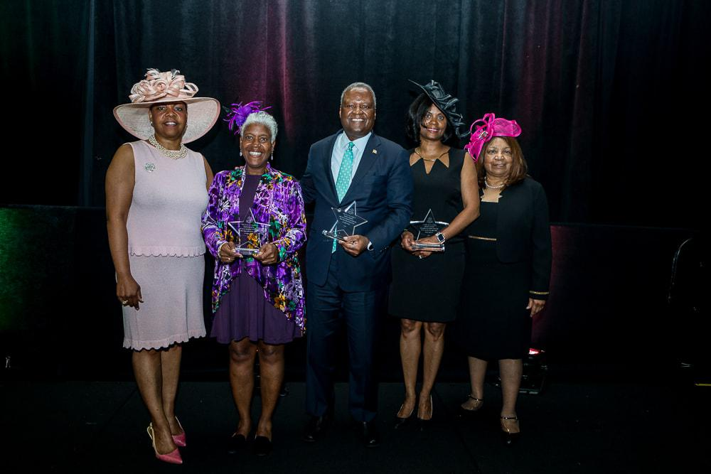 Prince George's County Executive Rushern Baker, III and Author Loretta Woodward Veney are honored.