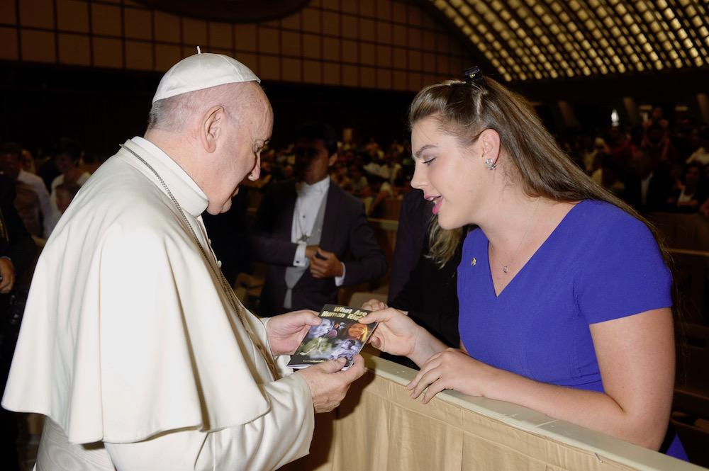 """Demme Durrett presents Pope Francis a """"What is Human Rights?"""" booklet at St. Peter's Bascilica"""