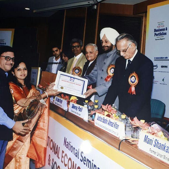 Shreekant Patil & Sneha Patil receiving award from Mr.Shivraj Patil