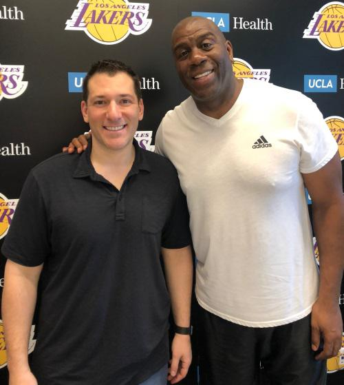 Press Pass Collectibles President, Kyle Bell, with Magic Johnson