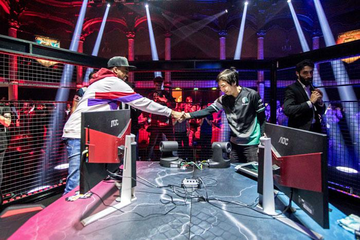 EVO Champion Problem X shakes hands with the winner Fujimura at the Red Bull Kumite World Final in Paris on November 11th, 2018