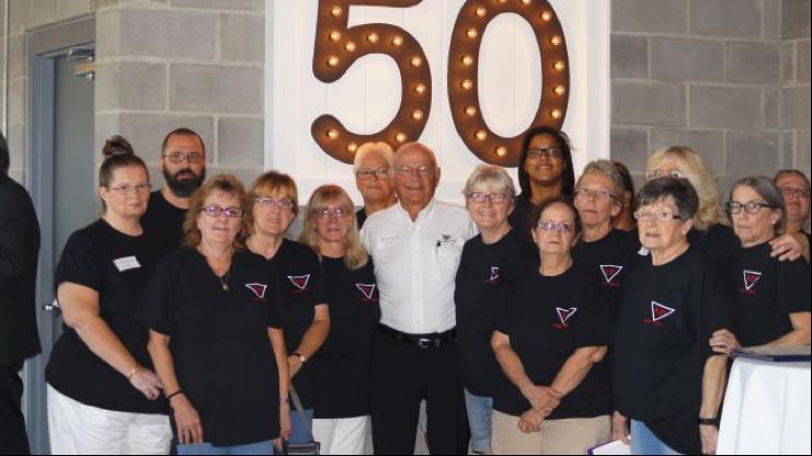 Founder Ken Groff with Venture Plastics Team members
