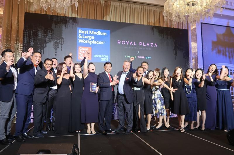 General Manager and Chief Experience Officer (CEO), Patrick Fiat, with hotel talents receiving the Singapore Best Workplaces Award