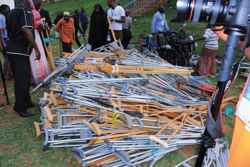 Disabled persons receiving free crutches and walking sticks from RCDA