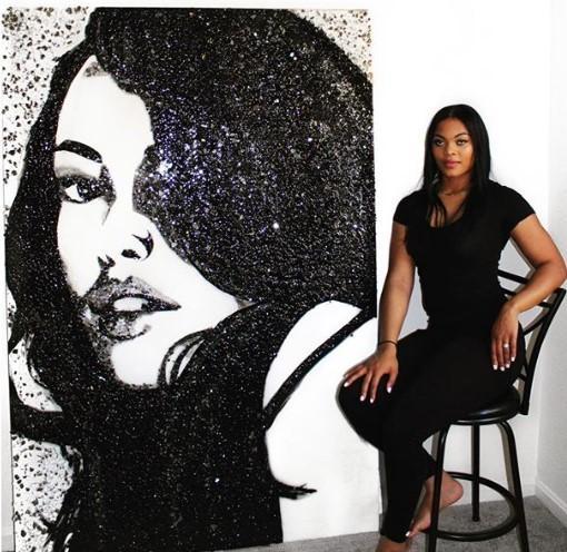 Artist Simone Agoussoye and one of her broken glass portraits