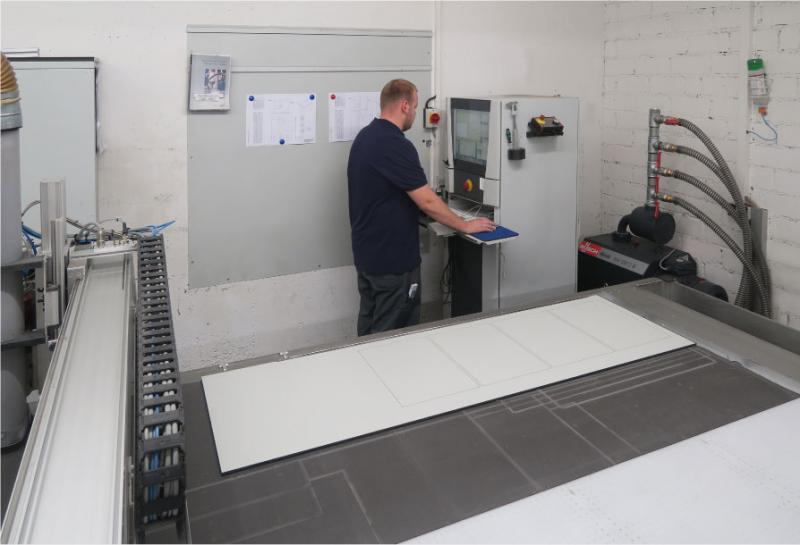 ASSTEC mills or engraves all its HPL panels on this CNC router