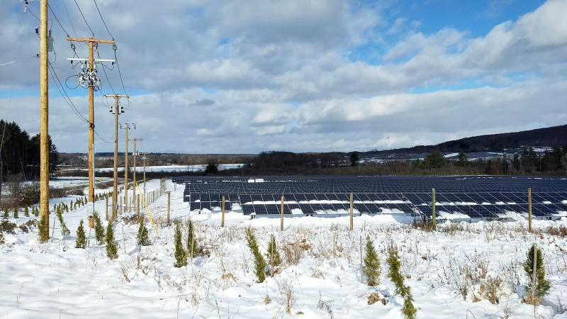 John Mills Electric Large Solar Project in Tompkins County, New York. Additionally, their electrical pole work is shown.