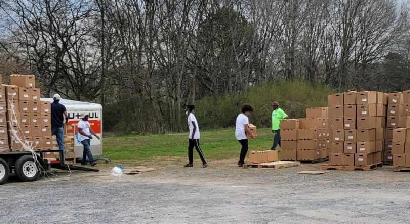 Camp Bohdi Team unloading food boxes.