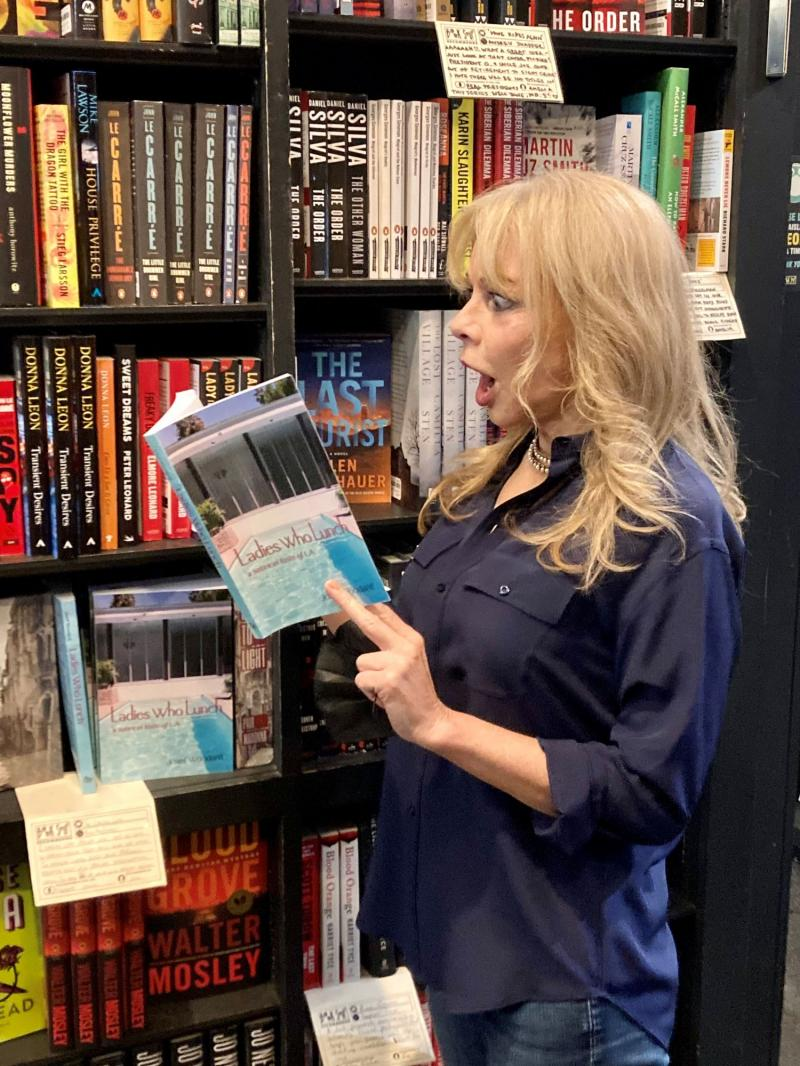 Audiobook narrator Katrina Leffler, shopping and apparently shocked, in Book Soup, the classic LA book emporium.